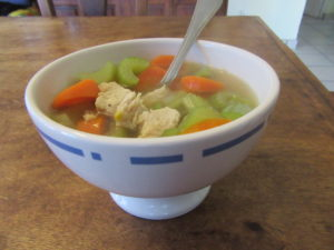 Chicken soup with onions, carrots, and celery